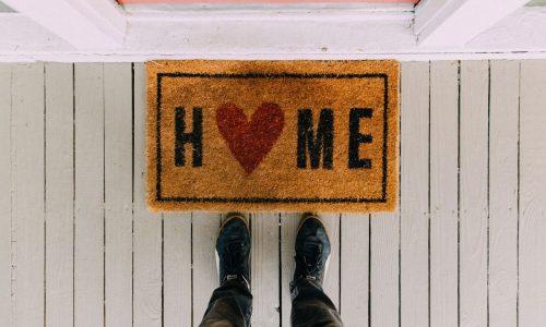 door mat that read home
