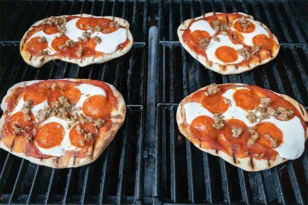 pizza on grill with toppings