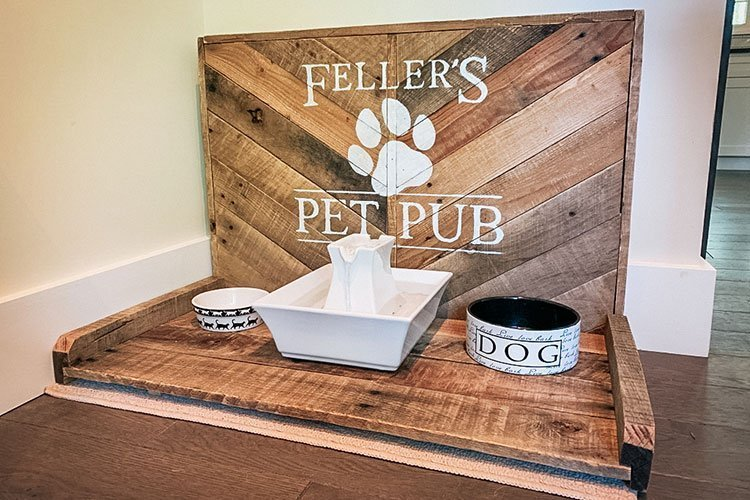 completed pet pub diy with water fountain and food bowls