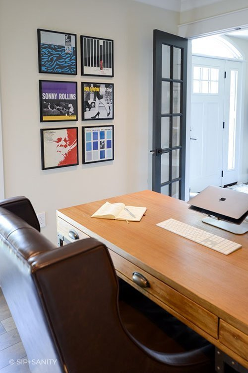 home office desk, chair and artwork