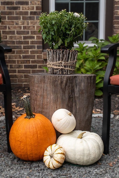 A pile of pumpkins on an autumn front porch