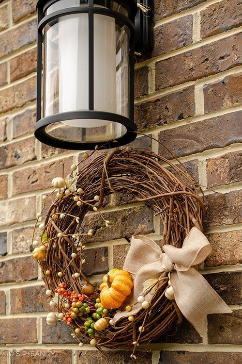 wreath hanging under porch light