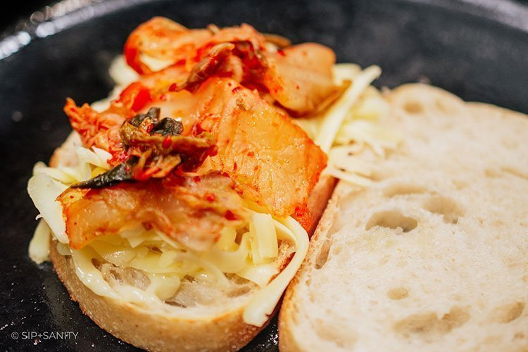 kimchi and cheese on top of bread