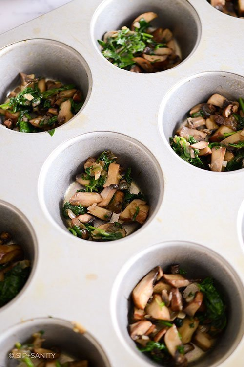 mushroom mixture in muffin tin
