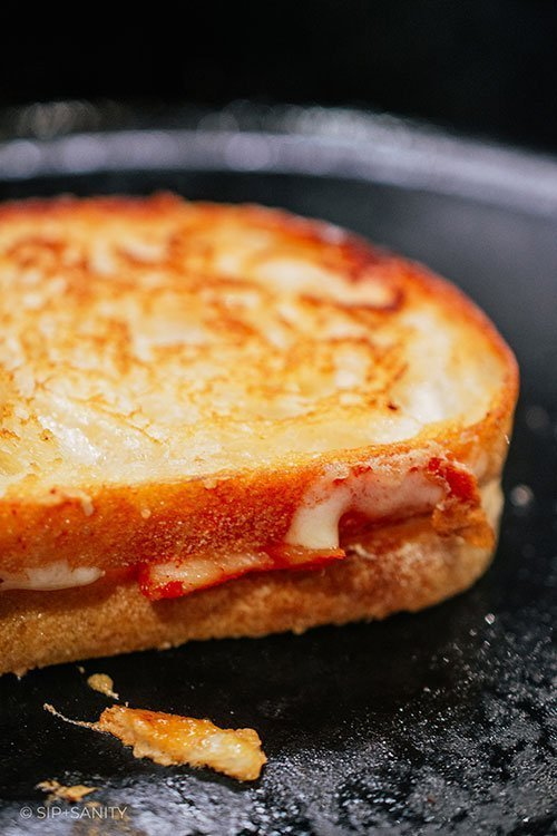 kimchi grilled cheese sandwich in pan