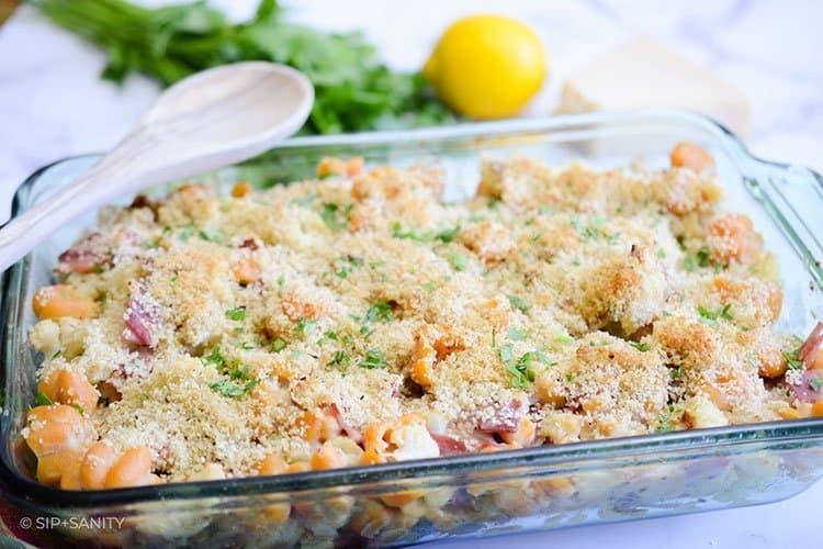 creamy roasted cauliflower pasta bake on a table
