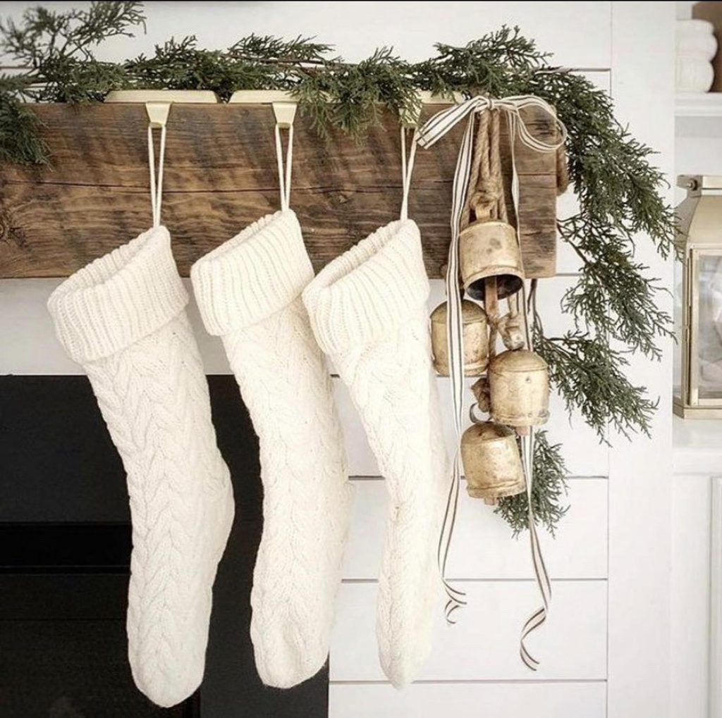 three knit stockings hanging from a mantle