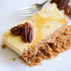 slice of pumpkin and maple semifreddo on a plate with a fork