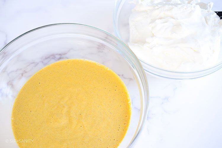 bowls of pumpkin custard and whipped cream