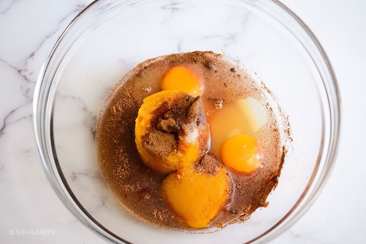 eggs, spices and pumpkin in a bowl