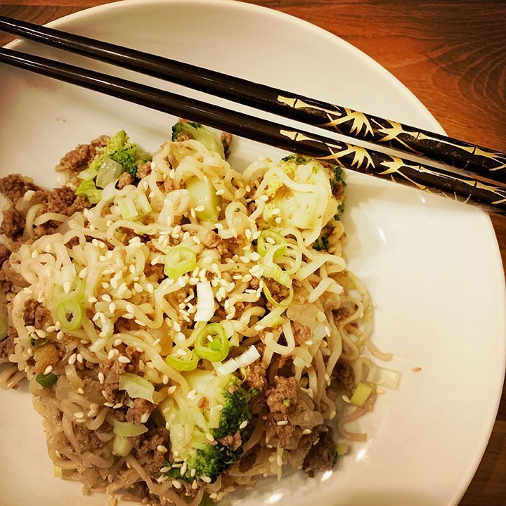 bowl of ramen noodles with broccoli
