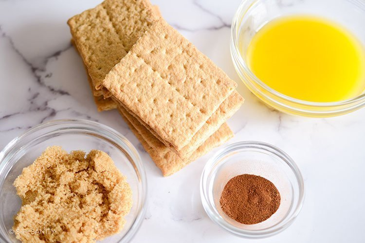 graham crackers, melted butter, brown sugar and spices on a counter
