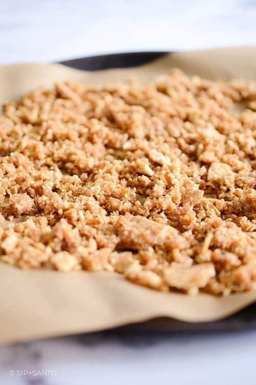 graham cracker crumbs on a sheet pan