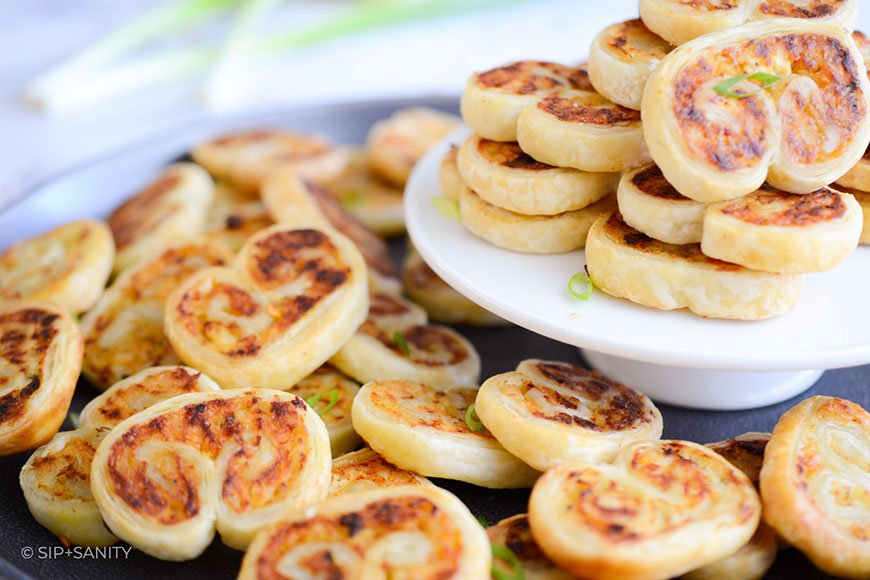 a closeup image of crab and goat cheese palmiers on a plate