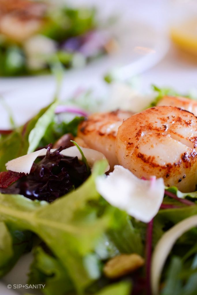 close up of pan seared scallop salad