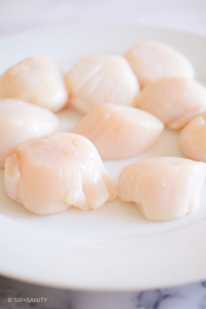 raw scallops on a plate