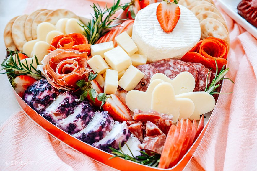 valentine's day indoor picnic heart shaped box of charcuterie