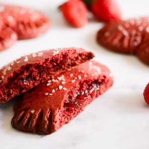 a red velvet pop tart split open to reveal filling