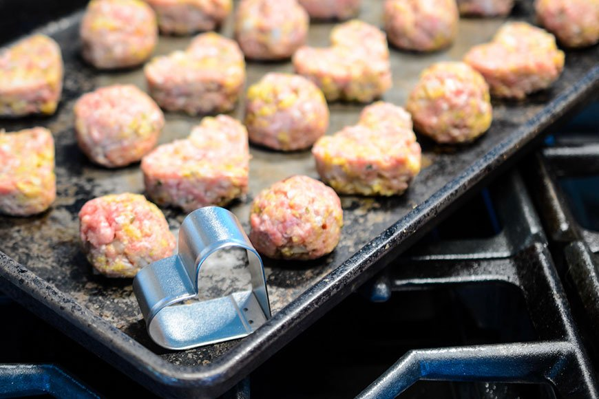pan full a meatballs and one heart cookie cutter