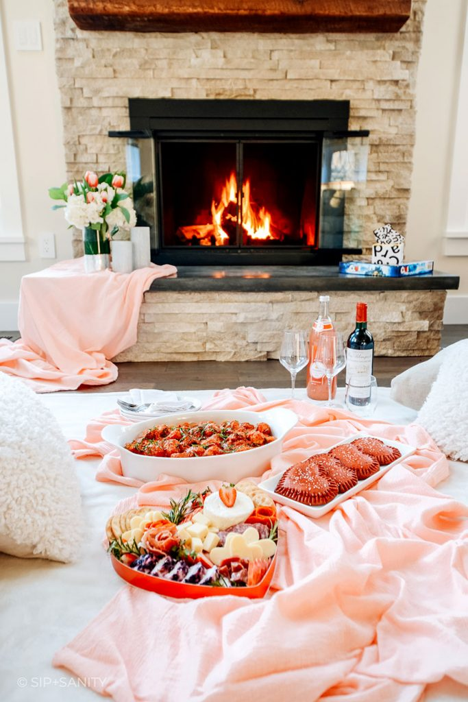 valentine's day indoor picnic by the fireplace