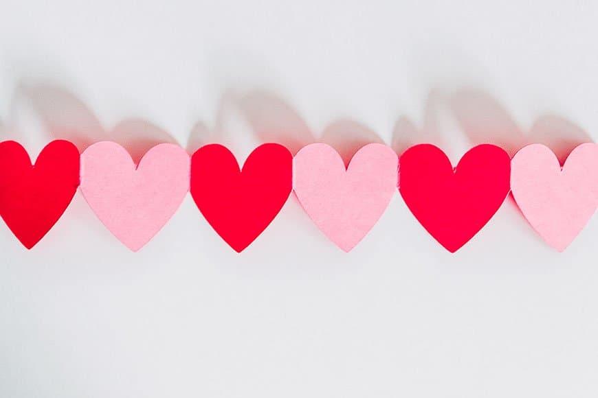 valentine paper hearts, Photo by Kelly Sikkema on Unsplash
