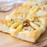 cashel blue cheese and pear tart on a cutting board