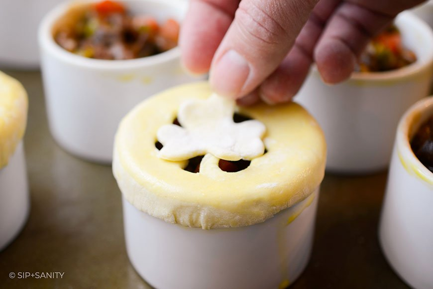 a shamrock shaped pastry being placed on a pie
