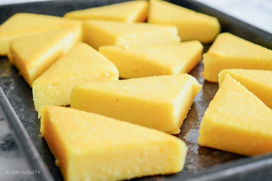 sheet pan with triangles of sautéed polenta