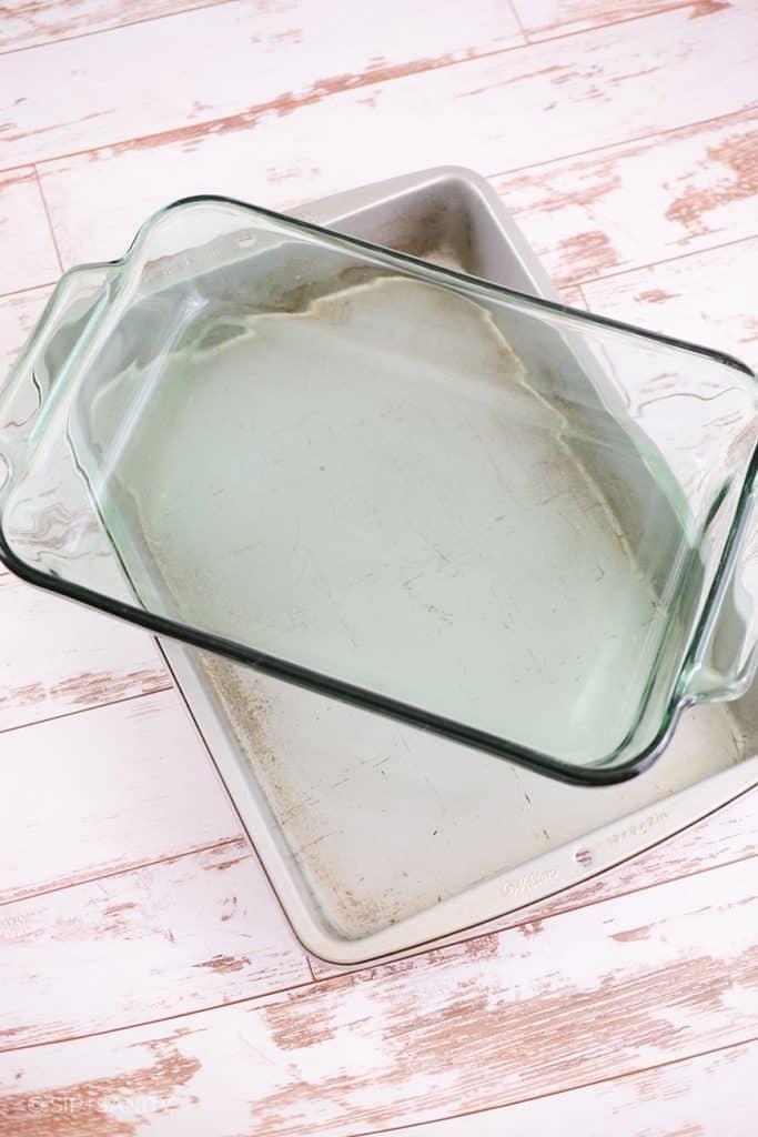 metal baking pan and glass casserole dish