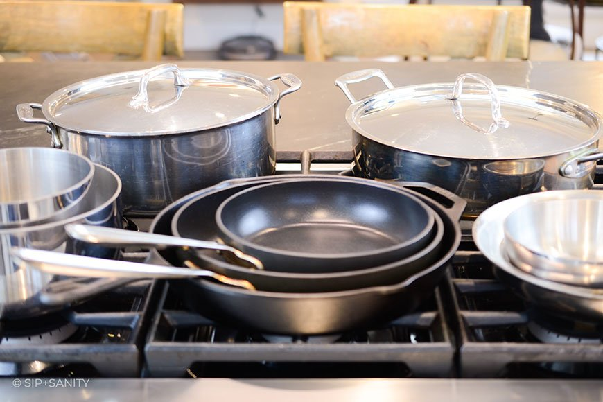 stacks of cookware on a stove top
