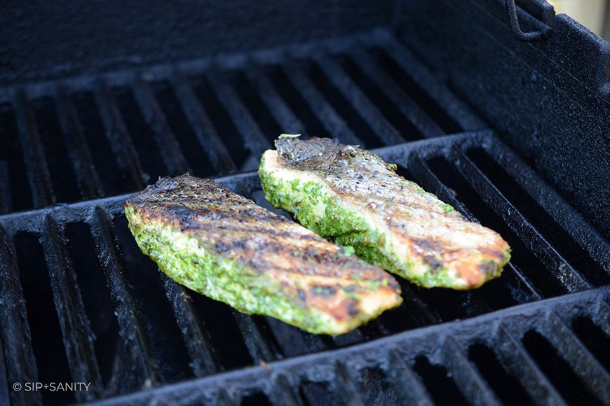 salmon skin side up on a grill