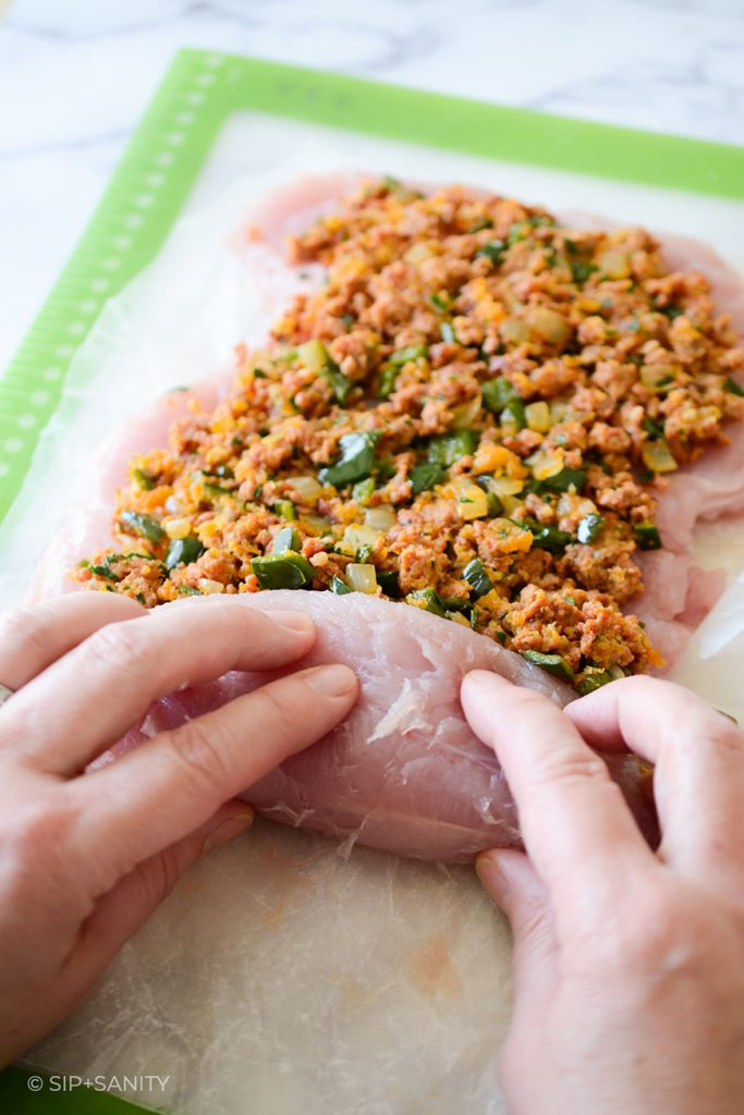 rolling up a turkey breast with chorizo stuffing