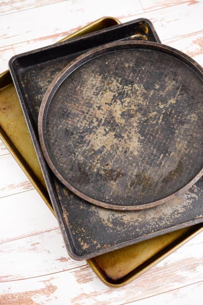 three metal baking pans