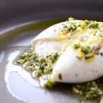 basil and lemon burrata appetizer on a plate