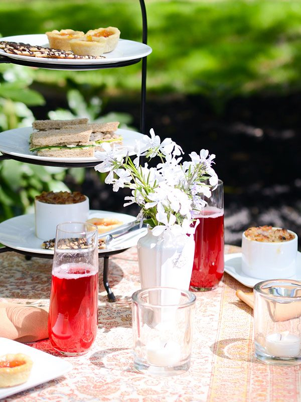 a tea service in a garden setting