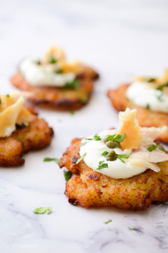 group of latkes with smoked trout