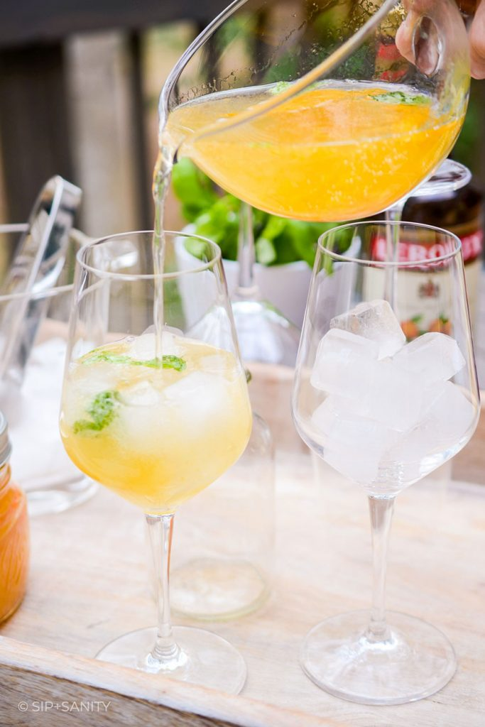 pouring sparkling sangria into a glass