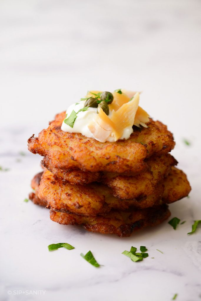 stack of latkes with smoked trout