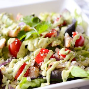 grilled chicken and corn salad with tomatoes and avocado lime dressing