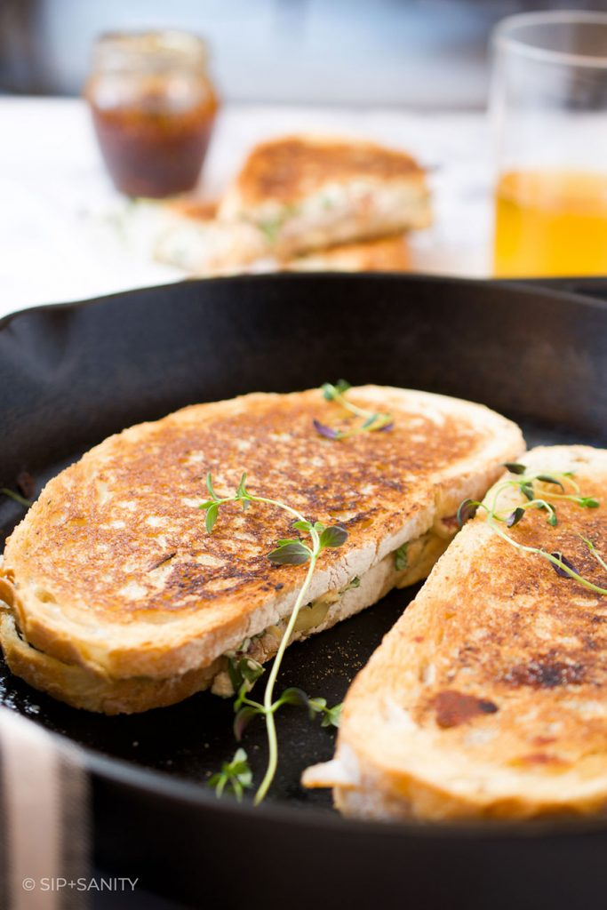 two sandwiches in a cast iron skillet