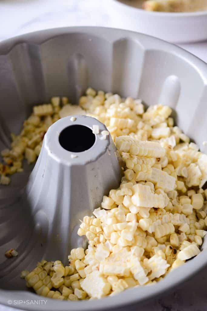 corn kernels collected in a bundt pan