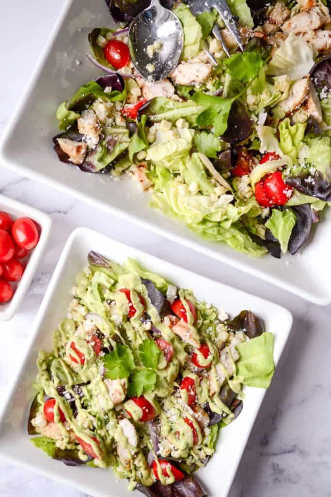 flat lay image of a serving bowl and individual bowl of salad