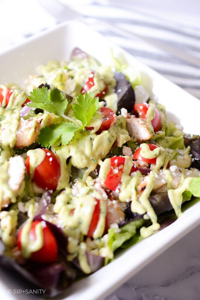 grilled chicken and corn salad with tomatoes and avocado dressing