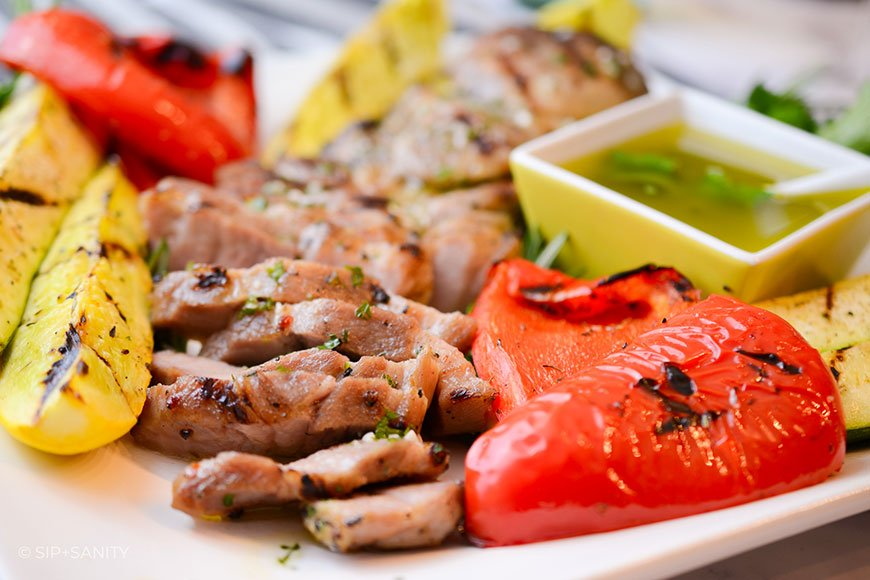 platter with grilled pork and veggies