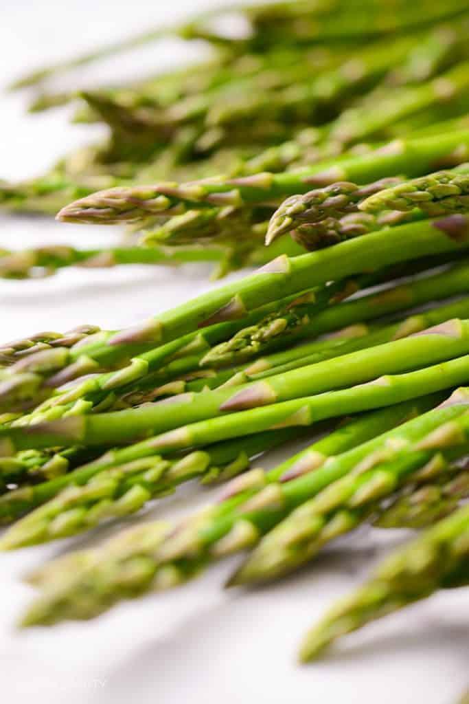 fresh asparagus laid out on a table