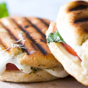 two tomato artichoke panini sandwiches
