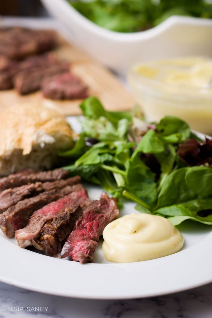 steak, salad, and French mayonnaise on a plate