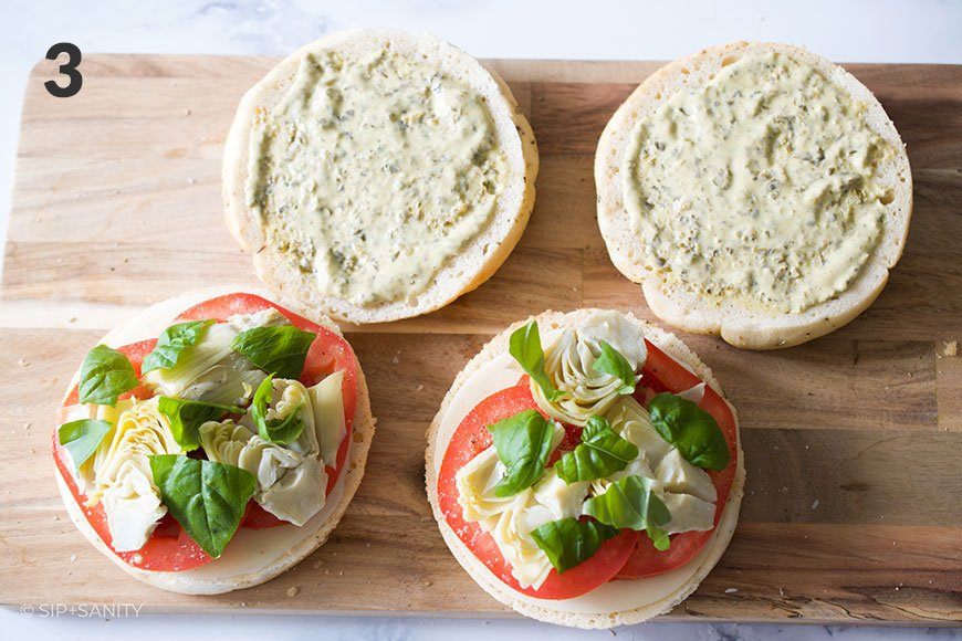 focaccia with artichokes and basil leaves
