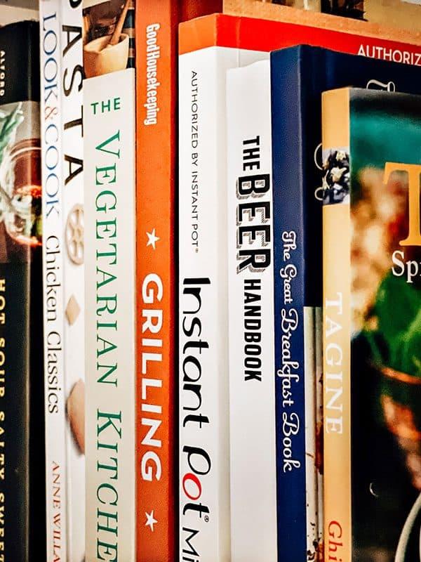 a line of cookbooks on a shelf