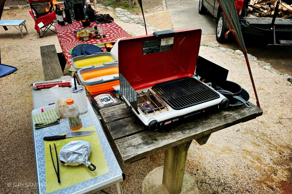 camp kitchen set up with stove, wash basins and other tools for making wine country recipes